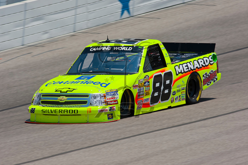 Fort Worth, TX - June 09, 2011:  Matt Crafton (88) brings his Camping World Truck Series truck through the turns during a practice session for the WinStar World Casino 400 race in Fort Worth, TX.