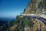 The most spectacular point on the Kalka Shimla mountain railway,Himachal Pradesh,India.The train is decorated to mark the first service from Kalka on the Centenary day of this railway which used a steam engine in the past.Today steam engines are used,occasionally, only for a part of the journey .