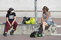 After the end of the quarantine in Italy the people begins again to working out in the city parks. In the photo: some people are taking a break in Piazza Valdo Fusi, Turin (Italy) on May 4, 2020. Photo by Marco Piovanotto/ABACAPRESS.COM