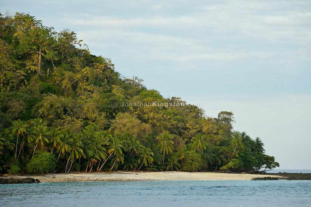 The pristine, palm-tree-lined beach of Isla Jicarita, Coiba National Park (Parque Nacional Coiba), gulf of Chiriqui, Panama.