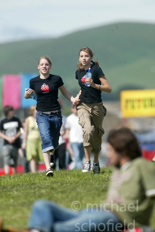 Fans arrive at the main stage area on the morning of Sunday 10th July, 2005 at the two-day T in the Park festival, at Balado, Kinross-shire, Scotland..