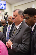 North Charleston Police Chief Eddie Driggers and Assistant Police Chief Reggie Burgess (right) following a healing service at Charity Missionary Baptist Church April 12, 2015 in North Charleston, South Carolina. Sharpton spoke following the recent fatal shooting of unarmed motorist Walter Scott police and thanked the Mayor and Police Chief for doing the right thing in charging the officer with murder.