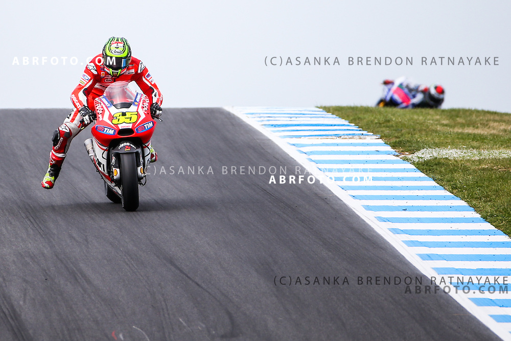 Cal Crutchlow  riding for Ducati Team  leads Jorge Lorenzo riding for Movistar Yamaha MotoGP during the 2014 MotoGP of Australia at Phillip Island Grand Prix Circuit in Phillip Island, Australia. Photo Asanka Brendon Ratnayake