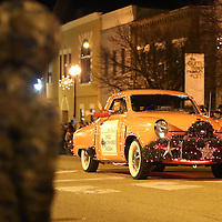 Adam Robison | BUY AT PHOTOS.DJOURNAL.COM<br /> A car from the Tupelo Automobile Museum drives in the Tupelo Christmas Parade Friday night.