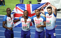 Great Britain's Men's 4x400m relay team (left to right) Dwayne Cowan, Rabah Yousif, Matthew Hudson-Smith and Martyn Rooney celebrate winning silver in the Final during day five of the 2018 European Athletics Championships at the Olympic Stadium, Berlin.