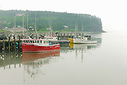 Fishing boats in harbour in fog<br /> Alma<br /> New Brunswick<br /> Canada