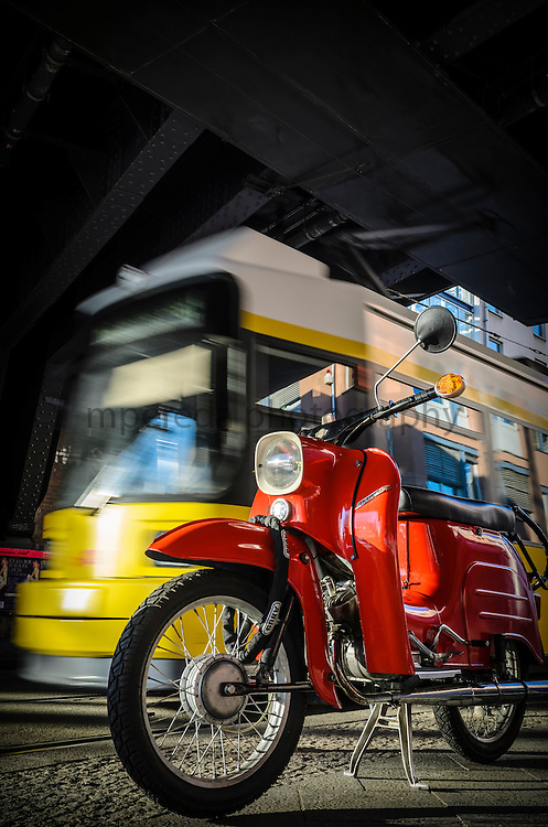 Motorbike and tram under a S-Bahn station