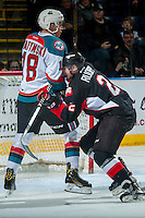 KELOWNA, CANADA - FEBRUARY 18: Sam Ruopp #2 of the Prince George Cougars checks Carsen Twarynski #18 of the Kelowna Rockets on February 18, 2017 at Prospera Place in Kelowna, British Columbia, Canada.  (Photo by Marissa Baecker/Shoot the Breeze)  *** Local Caption ***