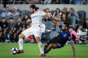 LAFC midfielder Lee Nguyen (24) battles for the ball with San Jose Earthquakes midfielder Anibal Godoy (20) during an MLS soccer match. LAFC defeated the San Jose Earthquakes 4-0 Wednesday, Aug. 21, 2019, in Los Angeles. (Ed Ruvalcaba/Image of Sport)