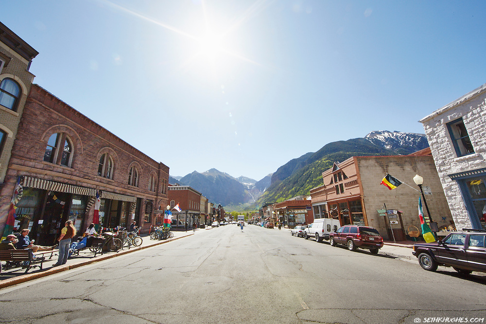 Telluride's rural charm seen from Colorado Avenue on crisp summer morning.