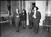U2 Meet An Taoiseach, Charles Haughey.    (R58)..1987..18.05.1987..05.18.1987..18th May 1987..After their highly successful tour of America, An Taoiseach, Charles Haughey welcomed U2 back to Ireland with a reception held in Iveagh House, Dublin. Iveagh House formerly a home to the Guinness family is now held by the Department of Foreign Affairs...Image shows The Edge (Dave Evans ) taking in the splendour of Iveagh House in the company of An Taoiseach, Charles Haughey