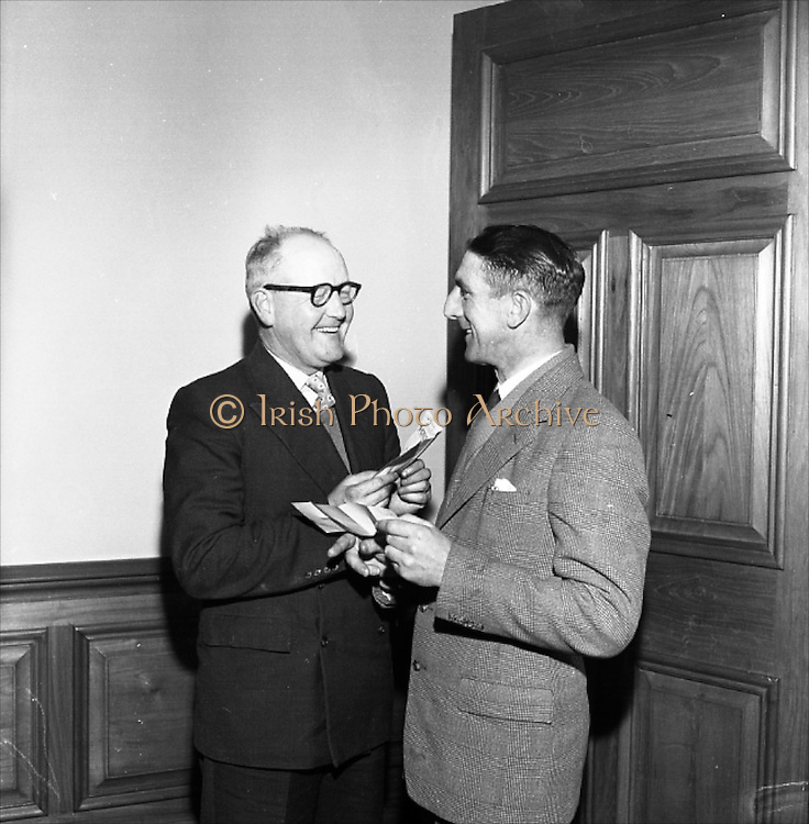 12/12/1960<br /> 12/12/1960<br /> 12 December 1960<br /> Cash bonuses for C.I.E. Traffic staff at Kingsbridge Station (Heuston Station) Dublin. The chairman of C.I.E., Dr. C.S. Andrews, presented cheques to 18 members of the Traffic Staff as a reward for their efforts in securing new business for the Board. Dr. Andrews said it was a great pleasure to recognise individual effort and added that he would like to see some scheme acceptable to the Trade Unions devised that would enable the earnings of individual workers to be related to their efforts. Picture shows (l-r): Passenger Inspectors F. Dunne, Limerick and E.F. Roche, Tralee after receiving their cheques from Dr. Andrews.