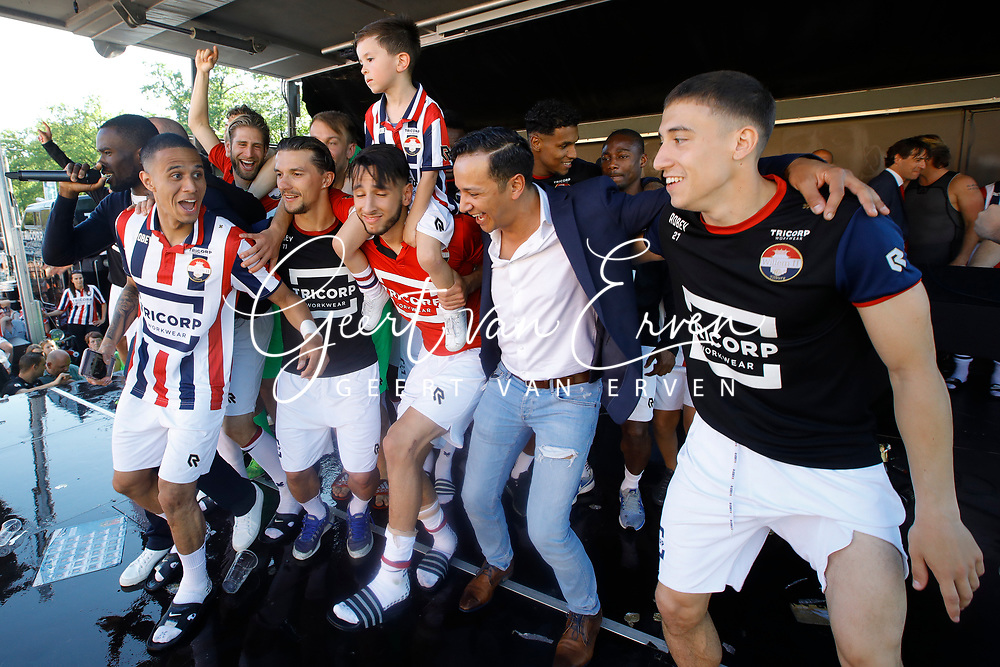 Supporters of Willem II celebrating the season with the players and staff, *Damil Dankerlui* of Willem II, *Timon Wellenreuther* of Willem II, *Ismail Azzaoui* of Willem II, *Kostas Tsimikas* of Willem II