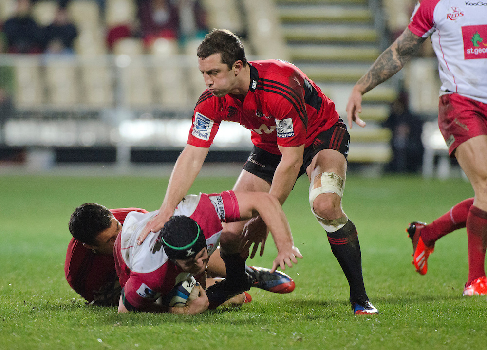 Reds Liam Gill in the tackle of Crusaders in the Super Rugby qualifier match at AMI Stadium, Christchurch, New Zealand, Saturday, July 20, 2013. Credit:SNPA / David Alexander