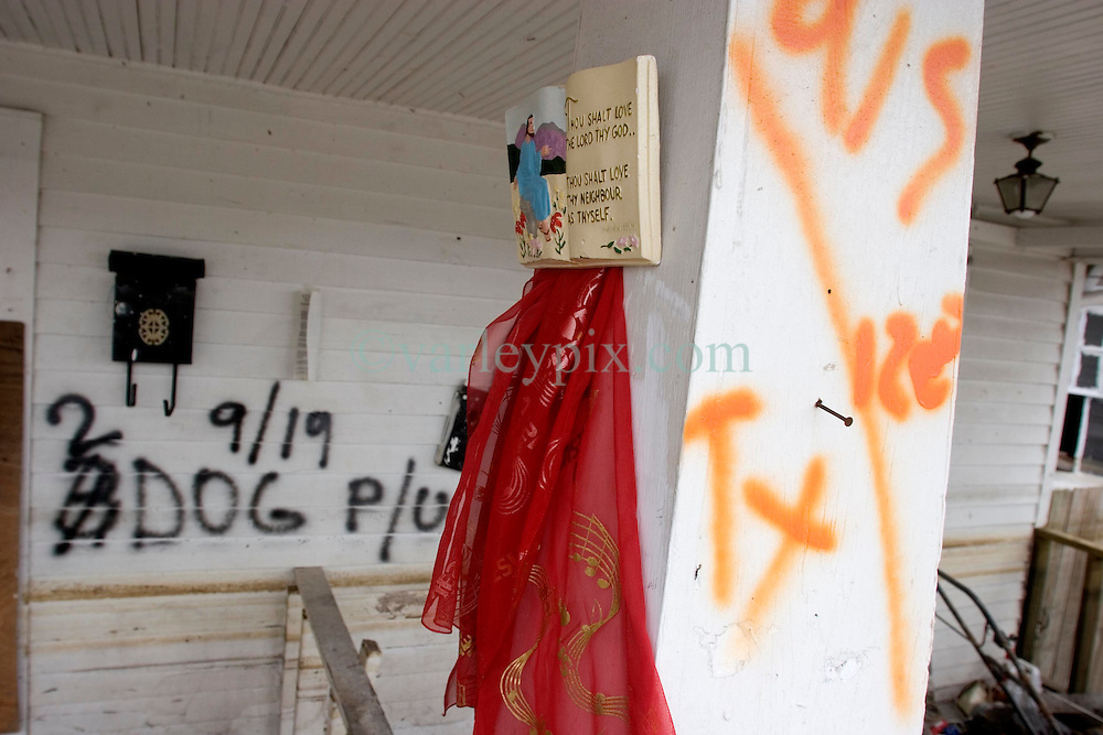 10 December 05.  New Orleans, Louisiana.  Post Hurricane Katrina. <br /> Rescue workers graffiti lingers on the walls of  Gentilly long after the devastating flood from Hurricane Katrina subsided. <br /> Photo; &copy;Charlie Varley/varleypix.com