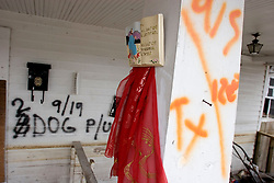 10 December 05.  New Orleans, Louisiana.  Post Hurricane Katrina. <br /> Rescue workers graffiti lingers on the walls of  Gentilly long after the devastating flood from Hurricane Katrina subsided. <br /> Photo; ©Charlie Varley/varleypix.com
