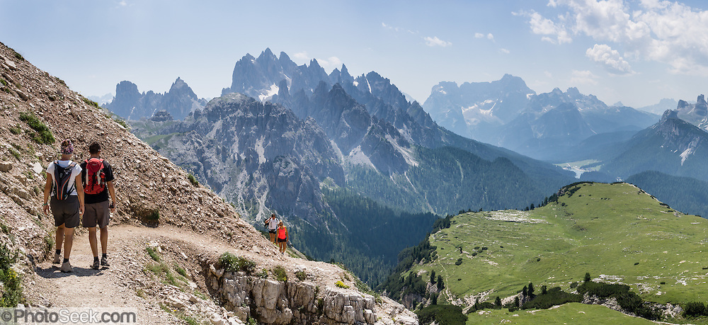 "The peaks of Cadini Group and Sorapiss Group rise (left to right) in the Dolomites, Veneto region, Italy, Europe. In the Cadini di Misurina, Cima Grande rises to 2999 meters (9839 feet), between Cima Piccola and Cima Ovest. Sorapiss is in the Ampezzo Dolomites. The Cadini Group is in the municipality of Auronzo di Cadore, in the Sesto Dolomites (Dolomiti di Sesto, or Sexten/Sextner/Sextener Dolomiten) which lie north of the Fiume Ansiei valley. From the Rifugio Auronzo toll road, hike for spectacular views around Tre Cime di Lavaredo (Italian for ""Three Peaks of Lavaredo,"" called Drei Zinnen or ""Three Merlons"" in German). The Dolomites are part of the Southern Limestone Alps. UNESCO honored the Dolomites as a natural World Heritage Site in 2009. This panorama was stitched from 3 overlapping photos."