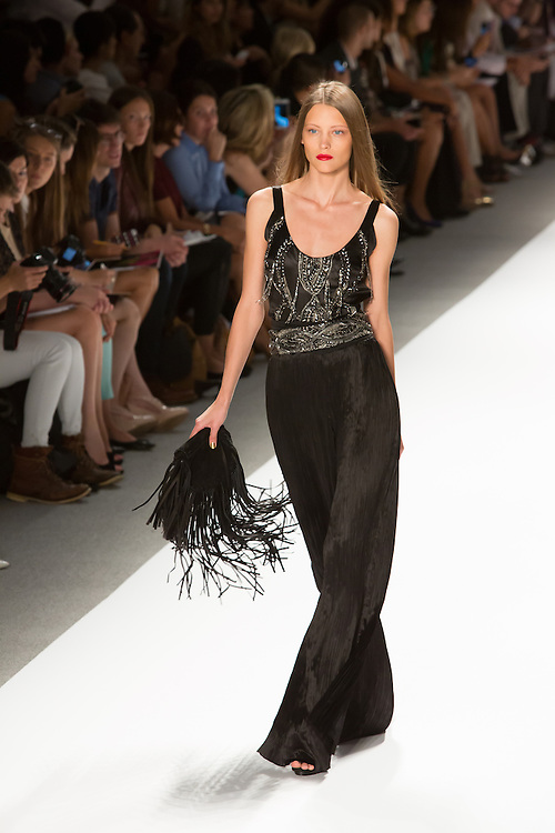 Evening trousers in a Fortunty-like black pleated silk with black sleveless beaded top.By Carlos Miele at the Spring 2013 Mercedes-Benz Fashion Week in New York.