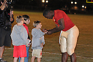 Lafayette High's Jeremy Liggins (1) signs autographs vs. New Albany in Oxford, Miss. on Friday, October 14, 2011. ..