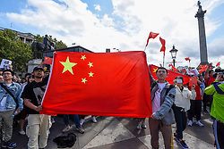 "© Licensed to London News Pictures. 17/08/2019. LONDON, UK.  Pro China demonstrators in Trafalgar Square take part in a counter protest against a solidarity rally for the people of Hong Kong.  Similar ""Global Solidarity with Hong Kong"" rallies are taking place worldwide as protests in the former British colony enter their tenth week demanding democratic reforms and a halt to police brutality.  Photo credit: Stephen Chung/LNP"