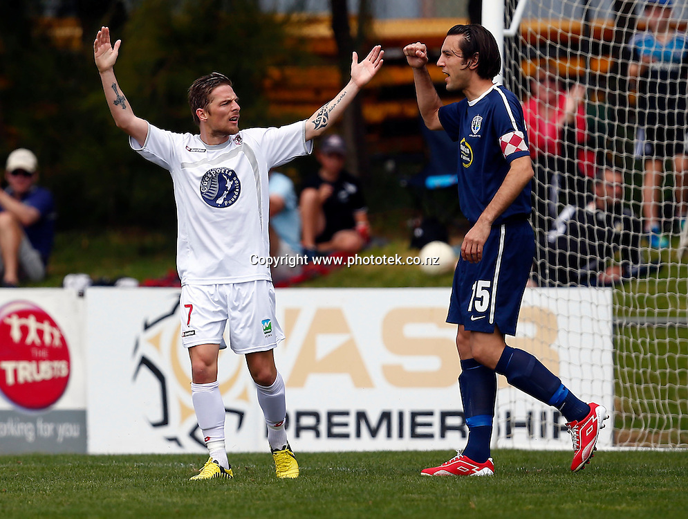 Waitakere's David Mulligan cannot believe that De Vries goal has been disallowed as Auckland's captain Ivan Vicelich celebrates the fact. ASB Premiership, Round Four, Waitakere United v Auckland City FC, Fred Taylor Park Whenuapai, Sunday 25th November 2012. Photo: Shane Wenzlick