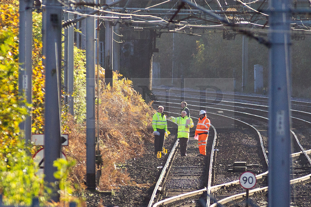 © Licensed to London News Pictures . FILE PICTURE DATED 27/10/2012 of police and forensic scenes of crime examiners searching an area of railway track near to Folly Lane , Warrington where seven stolen munitions packages were discovered as , today (16th September 2013) , six men are due to be sentenced at Liverpool Crown Court after MOD-owned munitions containing explosives were stolen from a freight train between Cumbria and Oxfordshire on Wednesday 24th October 2012 , prompting investigations by the North West Counter Terrorism Unit . Phillip Yates (born 25/9/83) of Church Street , Birkenhead , Kris Keith Black (born 05/10/1989) of Woodchurch Road , Birkenhead and David Ian Smith (born 3/2/1983) of Boothwood Close , Liverpool all pleaded guilty to theft and possessing explosives (under the Explosive Substances Act , 1883). Leonard Ash (born 20/09/1962) of Beckwith Street , Birkenhead , was found guilty after a trial of handling stolen goods and possessing explosives (under the Explosive Substances Act , 1883) and offences under Section 5(1)(AF) of the Firearms Act . Michael David Arthur Hellon (born 25.09.1981) of Hadfield Close , Sheffield was found guilty after a trial of handling stolen goods and possessing explosives (under the Explosive Substances Act , 1883). Jason McKee (born 11/9/86) of Valley Road , Bromborough was found guilty after a trial of handling stolen goods and possessing explosives (under the Explosive Substances Act , 1883). He also pleaded guilty to offences under Section 5(1)(AF) of the Firearms Act . Photo credit : Joel Goodman/LNP