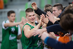 Players celebrate victory after basketball match between KK Union Olimpija and Khimki Moscow Region (RUS) in 9th Round of Regular season of Euroleague 2012/13 on December 7, 2012 in Arena Stozice, Ljubljana, Slovenia. Union Olimpija defeated Khimki Moscow Region 74:72. (Photo By Matic Klansek Velej / Sportida)