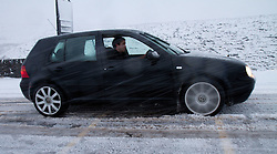 © Licensed to London News Pictures. 27/01/2012. Derbyshire, UK. A driver, with his wheels spinning on the ice, struggles with the impact of a severe snowfall along Derbyshire's notorious Snake Pass Road. Photo credit : Joel Goodman/LNP