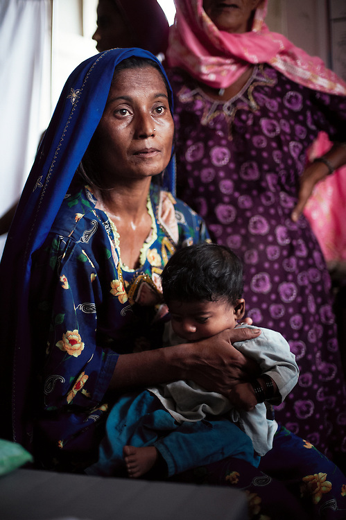 Havi Mahmood, 29 years old at the Government Health Clinic in the village of Babrio Jat, Thatta, Sindh, Pakistan on July 2, 2011. Her baby Rajab Mahmood is 5 months old, has been sick since birth and is malnourished. She has had 5 children that lived and 5 that died.