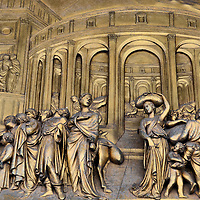 """Gates of Paradise Joseph East Door Panel on Florence Baptistery in Florence, Italy<br /> Construction of the octagonal Florence Baptistery was completed in 1128, which makes this minor basilica one of Florence's oldest buildings.  But its doors are more famous. A young goldsmith named Lorenzo Ghiberti won the competition to create a 28 panel door.  It took him 21 years.  The next year, in 1425, he was asked to create the """"Gates of Paradise"""" door which is now on the east side.  This gilded panel, """"Joseph Sold into Slavery,"""" is one of the ten panels that tell Old Testament stories.  This masterpiece took him an additional 27 years to create."""