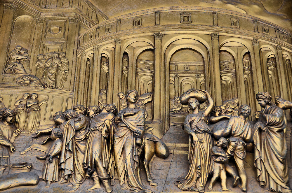 Gates of Paradise Joseph East Door Panel on Florence Baptistery in Florence, Italy<br /> Construction of the octagonal Florence Baptistery was completed in 1128, which makes this minor basilica one of Florence&rsquo;s oldest buildings.  But its doors are more famous. A young goldsmith named Lorenzo Ghiberti won the competition to create a 28 panel door.  It took him 21 years.  The next year, in 1425, he was asked to create the &ldquo;Gates of Paradise&rdquo; door which is now on the east side.  This gilded panel, &ldquo;Joseph Sold into Slavery,&rdquo; is one of the ten panels that tell Old Testament stories.  This masterpiece took him an additional 27 years to create.