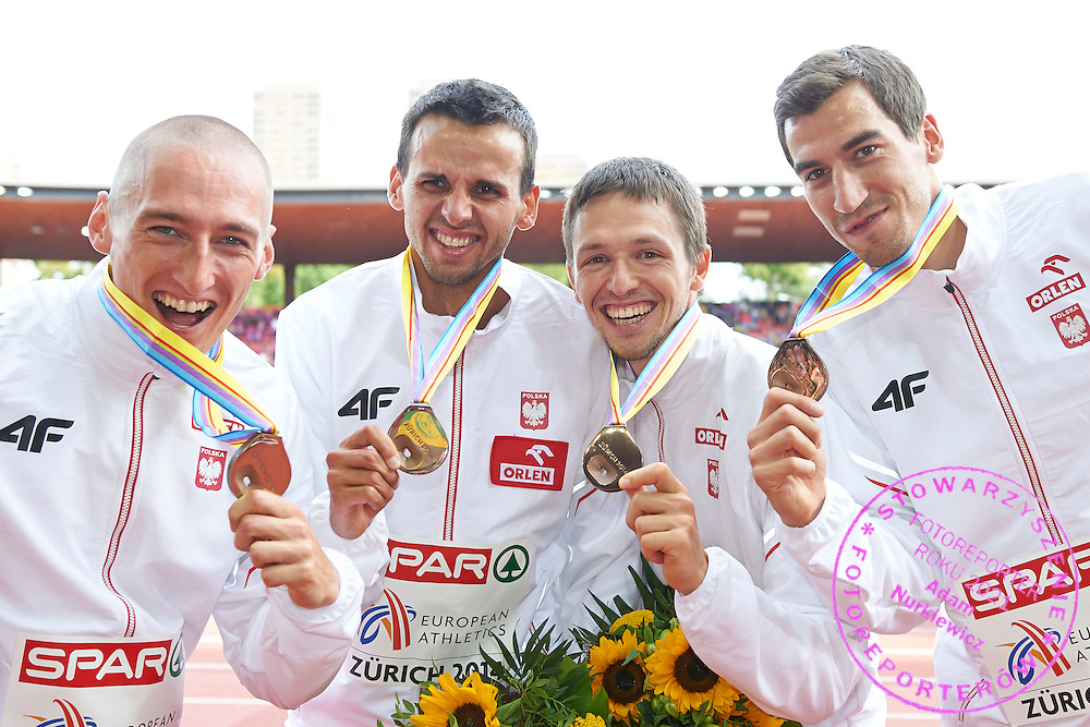 (L-R) Jakub Krzewina and Lukasz Krawczuk and Kacper Kozlowski and Rafal Omelko all from Poland pose with their bronze medals in relay 4  400 meters while medal ceremony during the Sixth Day of the European Athletics Championships Zurich 2014 at Letzigrund Stadium in Zurich, Switzerland.<br /> <br /> Switzerland, Zurich, August 17, 2014<br /> <br /> Picture also available in RAW (NEF) or TIFF format on special request.<br /> <br /> For editorial use only. Any commercial or promotional use requires permission.<br /> <br /> Photo by &copy; Adam Nurkiewicz / Mediasport