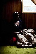 "Lettorea ""Lottie"" Clark, 25, sits for a portrait in the apartment she shares with her daughter Gabby, 2, in Albany, GA on Friday, October 24, 2008. Lottie and Gabby live off welfare after escaping an abusive relationship with Gabby's father."