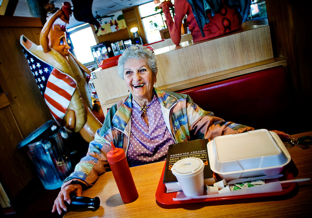 "Dorothy Urman at  ""U Lucky Dawg"", a hotdog restaurant that is a polling place in Chicago. She alrady voted for Obama...Photographer: Chris Maluszynski /MOMENT"