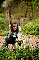 CALS student gets a closer look at flowers in the Humble Administrator's Garden in Suzhou.