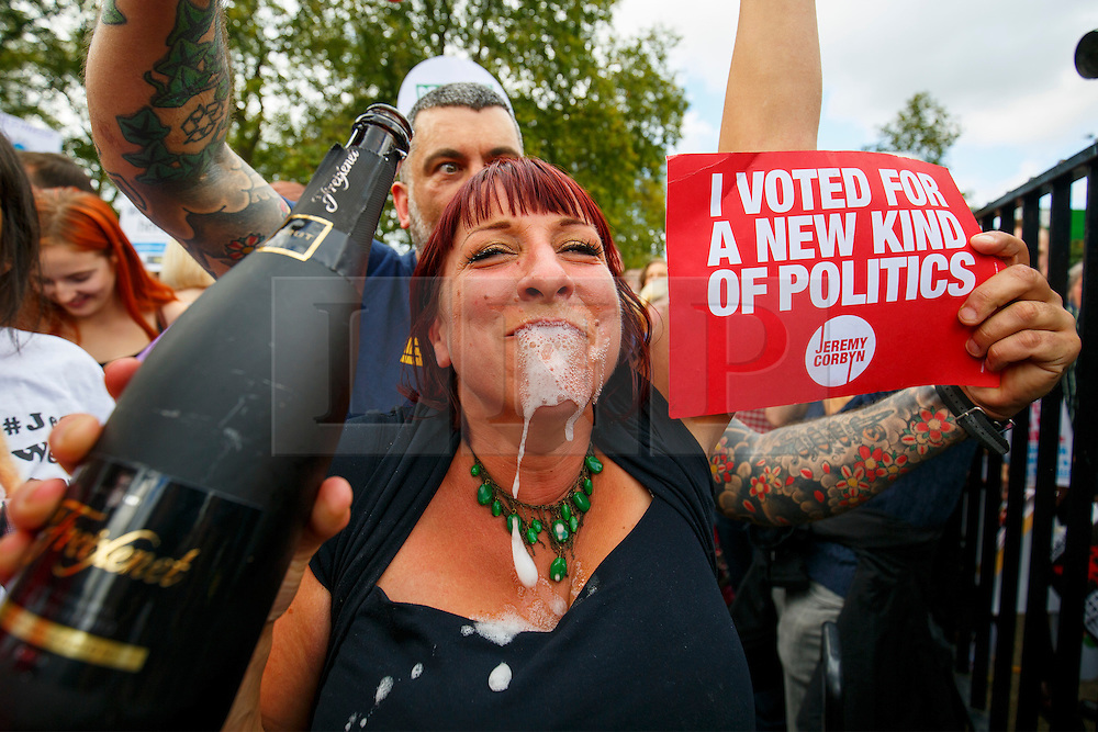 © Licensed to London News Pictures. 12/09/2015. London, UK. People celebrating Jeremy Corbyn's victory in Labour leadership election during a pro-refugee march in central London on September 12, 2015. Photo credit: Tolga Akmen/LNP