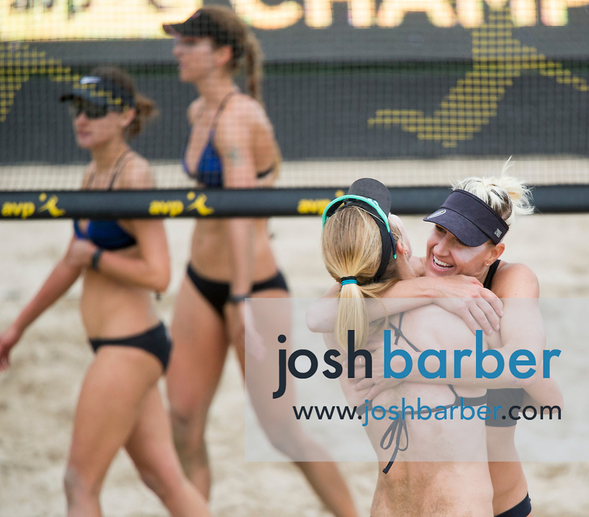 Emily Day and Brittany Hochevar celebrate as Betsi Flint and Kelley Larsen after winning the womens championship match of the AVP Huntington Beach Open at Huntington Beach Pier on Sunday, May 7, 2017 in Huntington Beach, California. (Photo/Josh Barber)