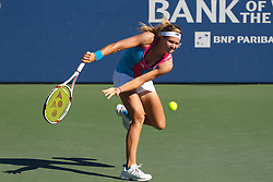 July 28, 2011; Stanford, CA, USA;  Maria Kirilenko (RUS) returns the ball against Serena Williams (USA), not pictured, during the second round of the Bank of the West Classic women's tennis tournament at the Taube Family Tennis Stadium.  Williams defeated Kirilenko 6-2, 3-6, 6-2.