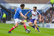 Rotherham United Midfielder, Jon Taylor (11) takes on Portsmouth Defender, Christian Burgess (6) during the EFL Sky Bet League 1 match between Portsmouth and Rotherham United at Fratton Park, Portsmouth, England on 3 September 2017. Photo by Adam Rivers.