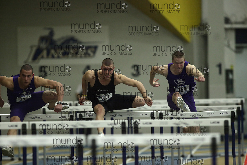 (Windsor, Ontario---12 March 2010) Matt Brisson of University of Western Ontario Mustangs   Tyler Fawcett of University of Ottawa Gee-Gees   Kevin O'Neill of University of Western Ontario Mustangs   competes in the 60m hurdles final at the 2010 Canadian Interuniversity Sport Track and Field Championships at the St. Denis Center. Photograph copyright Nicole Osborne/Mundo Sport Images. www.mundosportimages.com