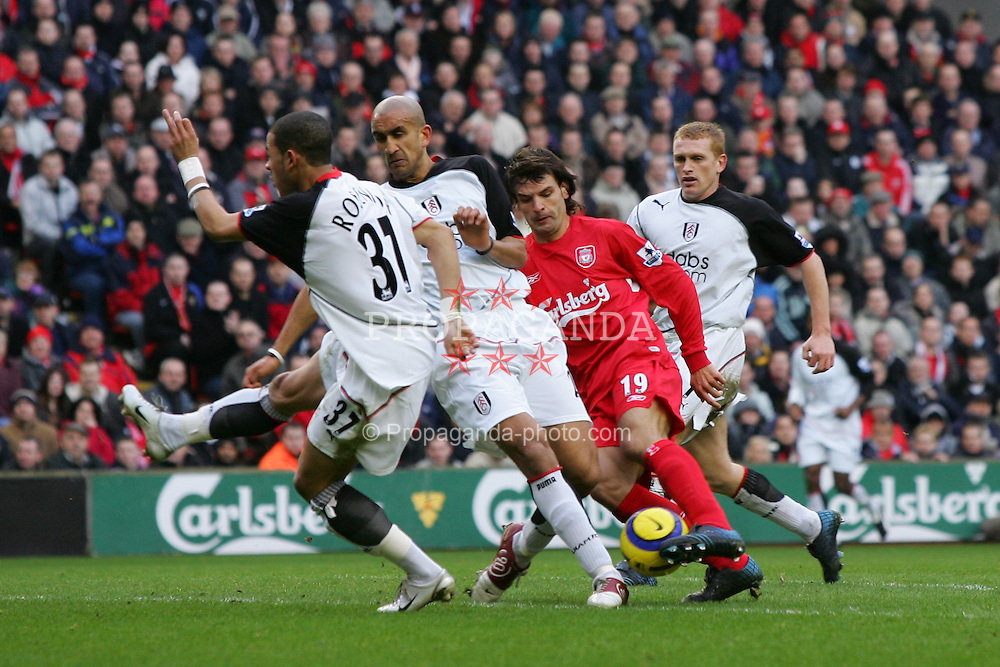 LIVERPOOL, ENGLAND - SATURDAY FEBRUARY 5th 2005: Liverpool's Fernando Morientes get in between three Fulham players during the Premiership match at Anfield. (Pic by David Rawcliffe/Propaganda)