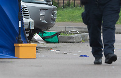 © Licensed to London News Pictures. 20/03/2017. London, UK. Medical equipment can be seen on the ground at the scene of a fatal shooting in Barking, east London, where an 18 year old man was shot in the head on Sunday evening. Photo credit: Peter Macdiarmid/LNP