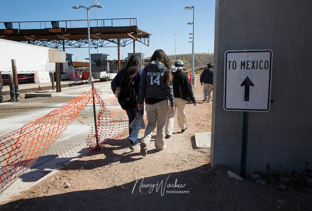"A group of Kino Teens make their way to into Mexico at the Mariposa border crossing in Nogales, Ariz. They were on their way to serve dinner at the ""comedor, the kitchen and dinning hall of the ""Centro de Atencion al Migrante Deportado,"" the Aid Center for Deported Migrants, in Nogales, Sonora. (Photo taken April 2, 2014) (Photo by Nancy Wiechec)"