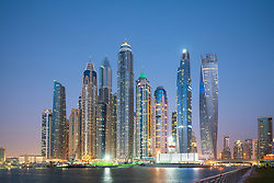 Many high rise apartment towers and skyscrapers at dusk in Marina district of Dubai, UAE, United Arab Emirates.