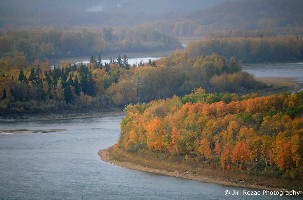 CANADA ALBERTA PACE RIVER 12OCT09 - Peace River during a misty morning in northern Alberta, Canada...Significant deposits of Bitumen, also known as tarsands have been found in the area around Peace River and Slave Lake, thus threatening the continued existence of flora and fauna of the Boreal through oil and gas developments...The Canadian boreal region represents a tract of land over 1,000 kilometres wide separating the tundra in the north and temperate rain forest and deciduous woodlands that predominate in the most southerly and westerly parts of Canada. ..The boreal region contains about 14% of Canada's population. With its sheer vastness and integrity, the boreal makes an important contribution to the rural and aboriginal economies of Canada, primarily through resource industries, recreation, hunting, fishing and eco-tourism...Photo by Jiri Rezac / GREENPEACE