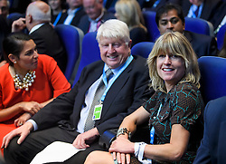 © Licensed to London News Pictures. 02/10/2018. Birmingham, UK. PRITI PATEL MP, STANLEY JOHNSON (father of Boris Johnson) and RACHEL JOHNSON (Sister of Boris Johnson) wait for Boris Johnson arrives on stage to deliver a speech at day three of the 2018 Conservative Party conference at the ICC in Birmingham, where he is due to speak. This years event is focused heavily on Brexit and negotiations with the EU over the UK's exit form the European Union. Photo credit: Ben Cawthra/LNP