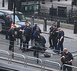 © Licensed to London News Pictures. 27/04/2017. London, UK. Armed police and over a man being arrested,  carrying  a bag containing knives, on Whitehall in Westminster, central London. Photo credit: Dev Howard/LNP