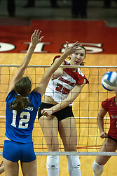 26 September 2006: Redbird Kari Staehlin slams an inside hit past Billiken blocker Lauren Christman. The match was tough and it took the Illinois State Redbirds 5 games to defeat the St. Louis University Billikens. The match took place at Redbird Arena on the campus of Illinois State University in Normal Illinois.