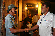 Santos Dumont_MG, Brasil...Funcionario cumprimentando um homem beneficiado da eletrificacao rural...A employee greeting man benefited from rural electrification...Foto: LEO DRUMOND / NITRO