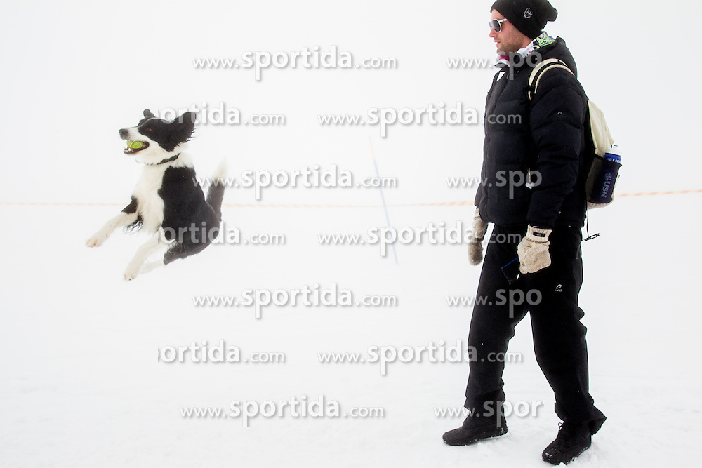 Gasper Markic with his dog during last race of Andrej Jerman, Slovenian best downhill skier when he finished his professional alpine ski career on April 6, 2013 in Krvavec Ski resort, Slovenia. (Photo By Vid Ponikvar / Sportida)